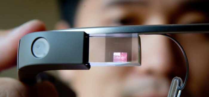 Software developer Brian Ho holds a Google Glass device at Vandrico, a Canadian company specializing in wearable computing, during a demonstration for the media in North Vancouver, B.C., on Tuesday July 30, 2013. The company is developing software for the device which is one of only a few in the country. (AP Photo/The Canadian Press, Darryl Dyck)