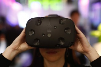 An employee demonstrates an HTC Vibe VR virtual reality headset in the HTC Corp. pavilion at the Mobile World Congress in Barcelona, Spain, on Tuesday, March 3, 2015. The event, which generates several hundred million euros in revenue for the city of Barcelona each year, also means the world for a week turns its attention back to Europe for the latest in technology, despite a lagging ecosystem. Photographer: Simon Dawson/Bloomberg